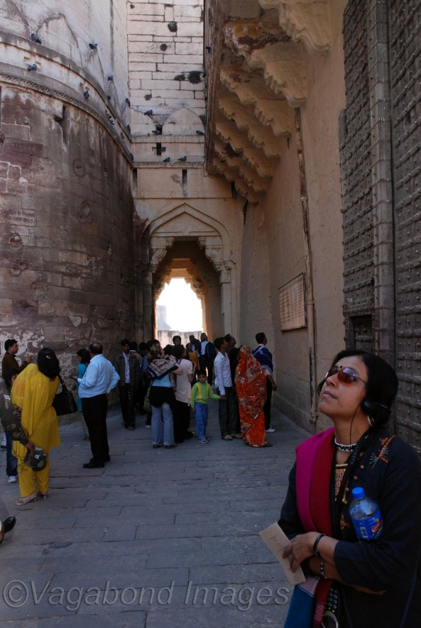 A tourist listening an audio guide at Mehrangarh Fort at Jodhpur in Rajasthan, India