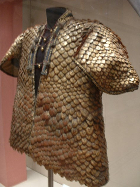 A coat of armor made of pangolin scales, an unusual object, was presented to George III in 1820.
