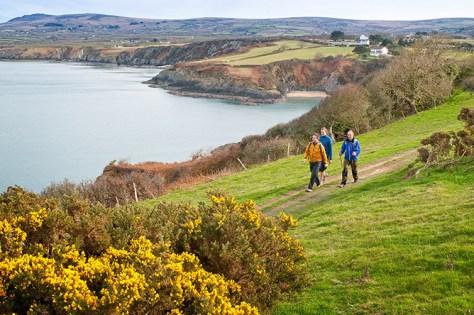 Walkers on Coast Path near Cwm-yr-Eglwys Pembrokeshire South