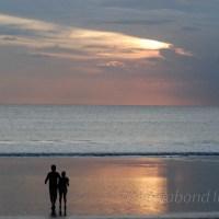Sunset silhouettes at Kuta Beach in Bali