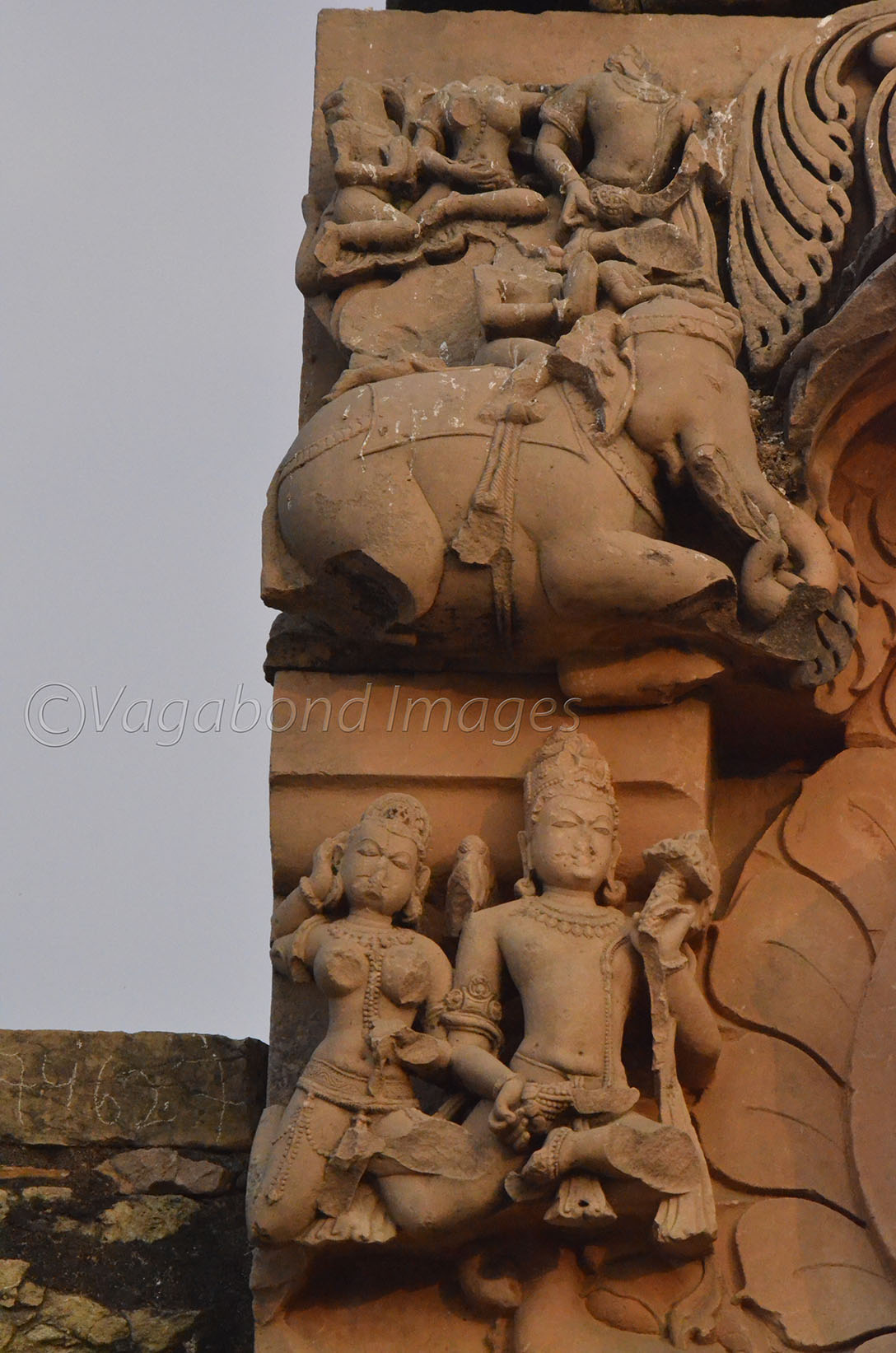 sculptures on left top panel of the statue