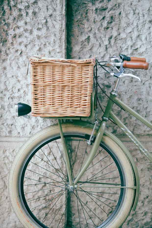 vintage bicycle with basket near wall