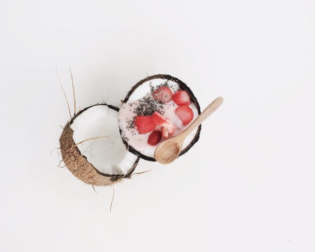coconut filled with small slices of red fruits and chia