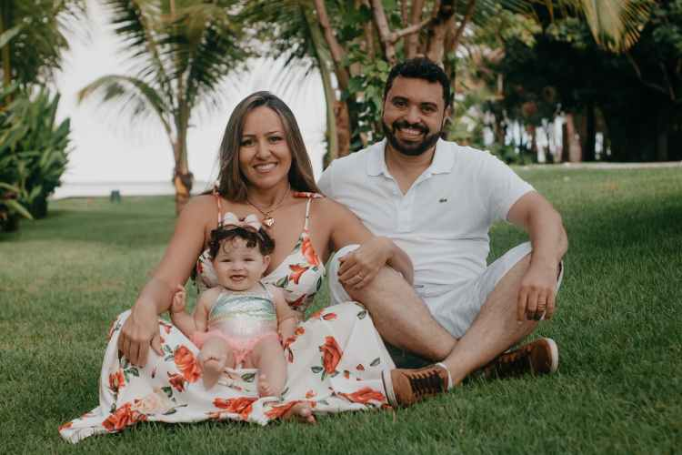 happy diverse family resting on lawn in tropical park