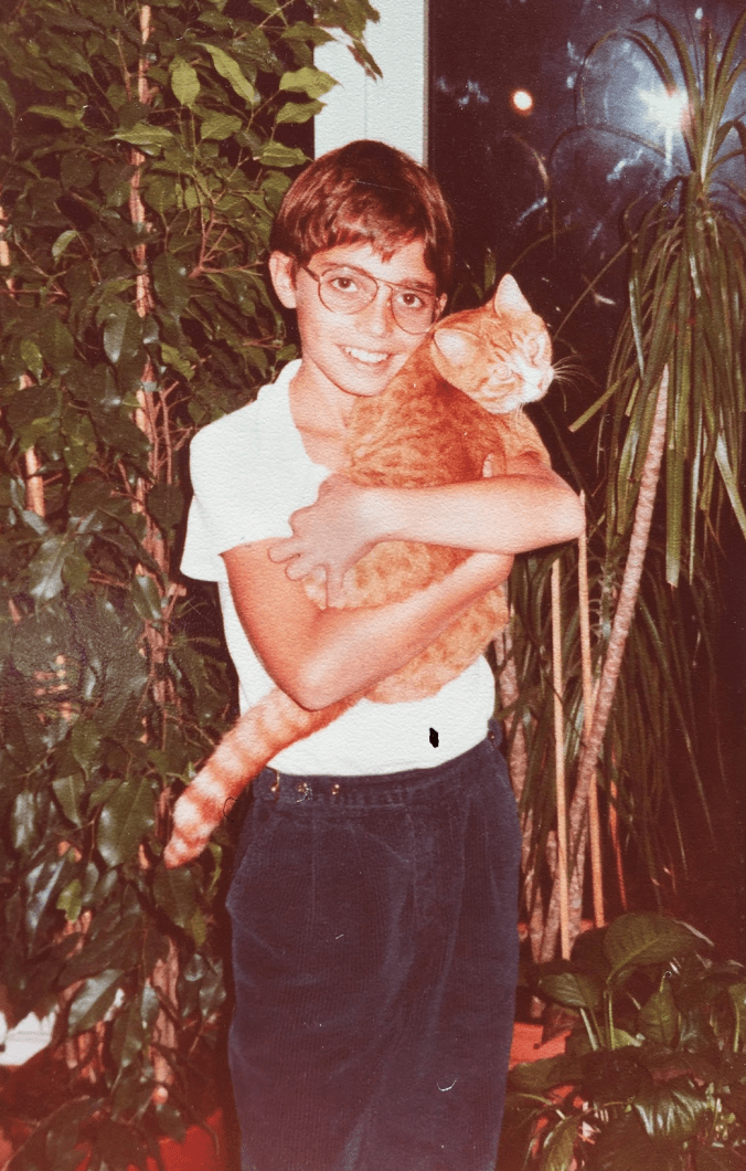 Young Vaillant with his cat