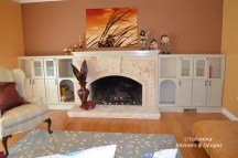 Travertine stone fireplace and wood mantel