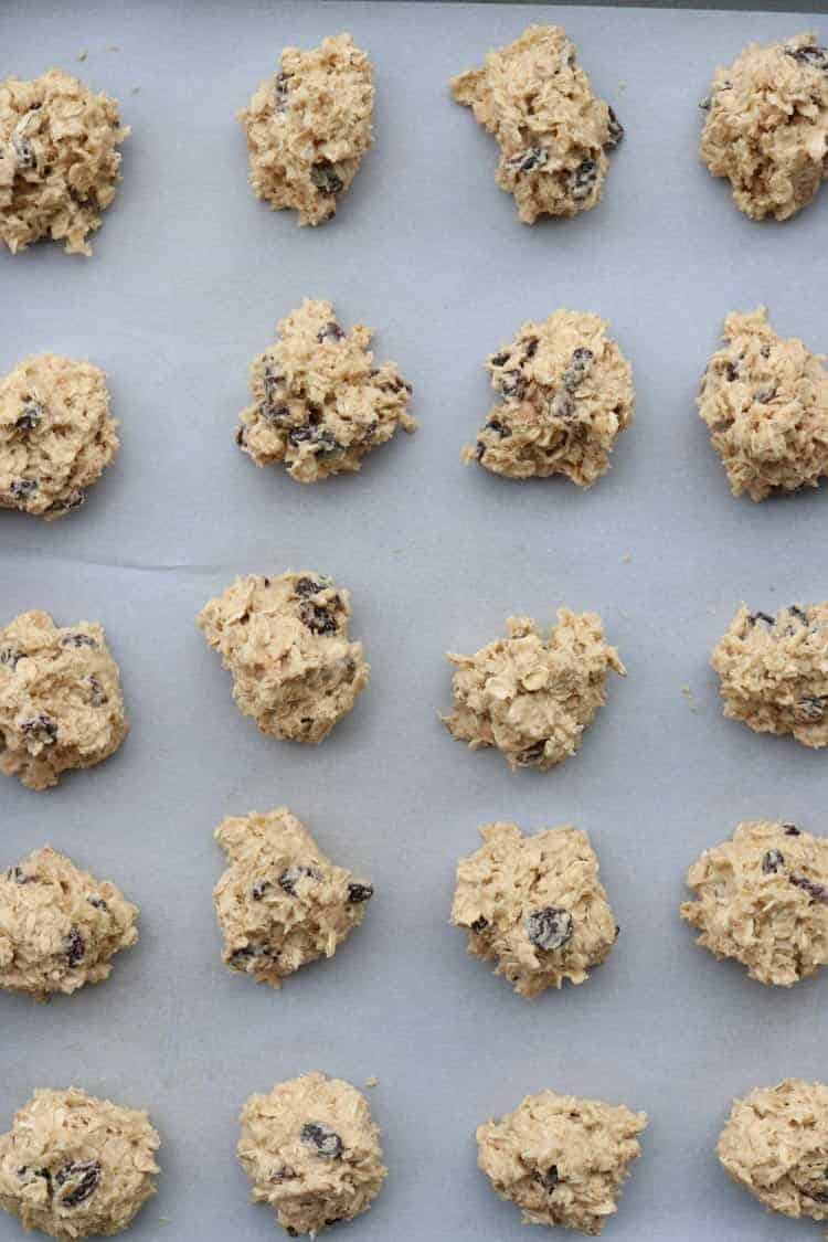 How to for oatmeal cookies into balls and placing them to baking sheet.