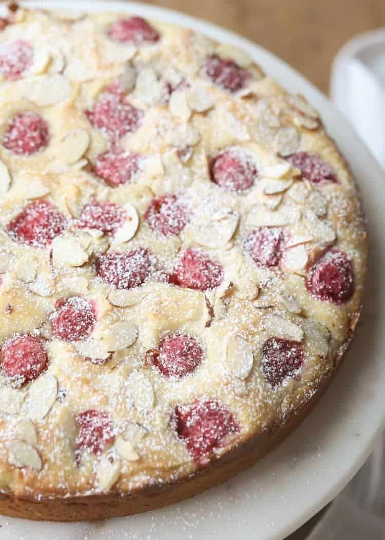 Close up Raspberry coffee cake on a cake stand.