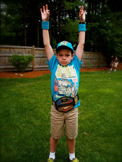 And my nephew in his WWE garb, which he is very proud of. so frqn cute.