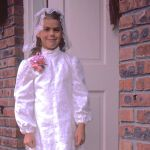 dark haired little girl in communion outfit