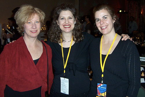 Three women with Sedona Film Festival badges