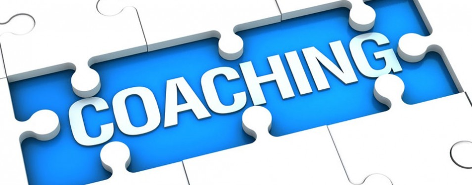 "A puzzle board reading: ""Coaching"""