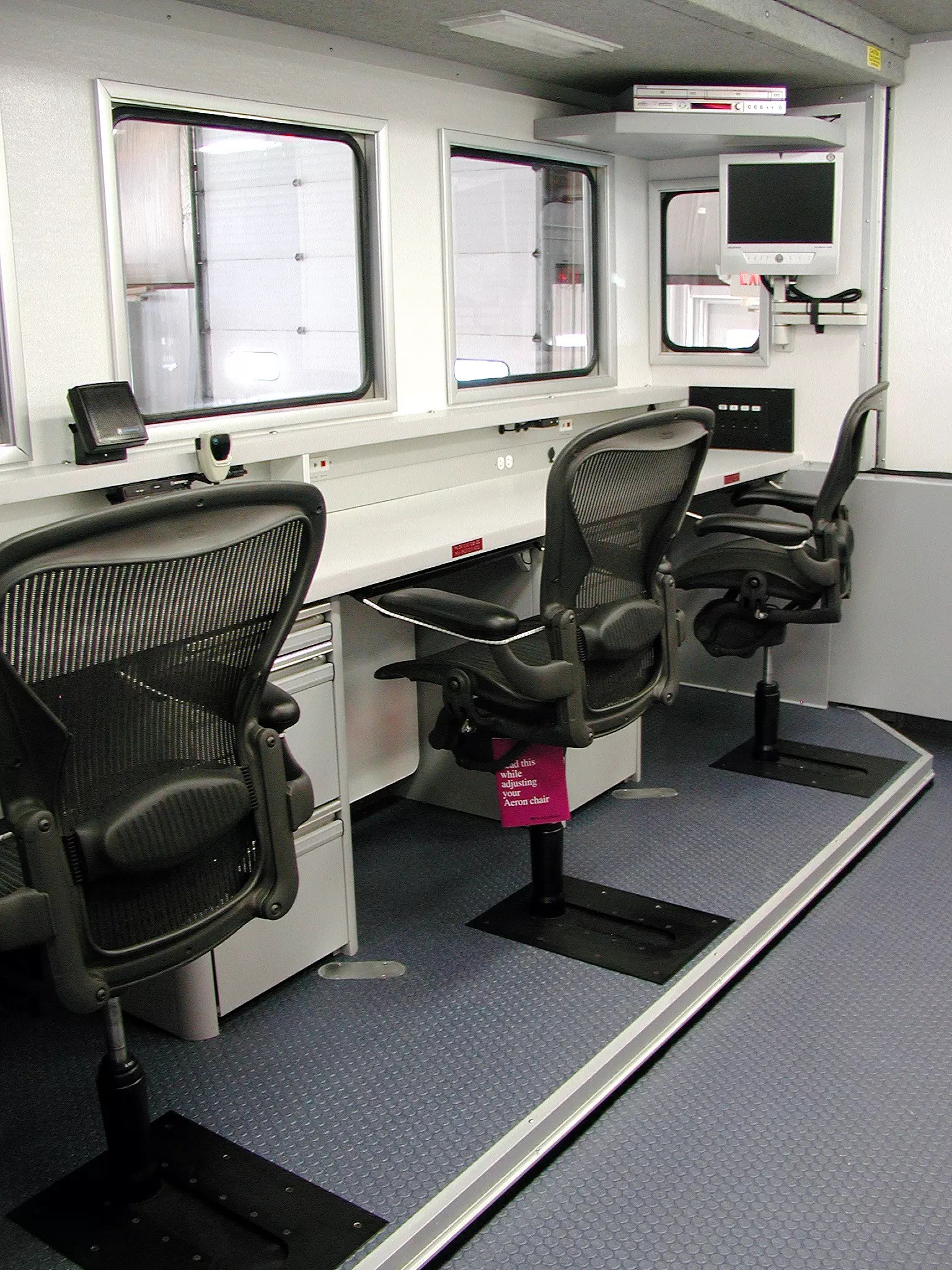 Workstation with three office chairs in a row that are equipped with Valid's adjustable chair slides.