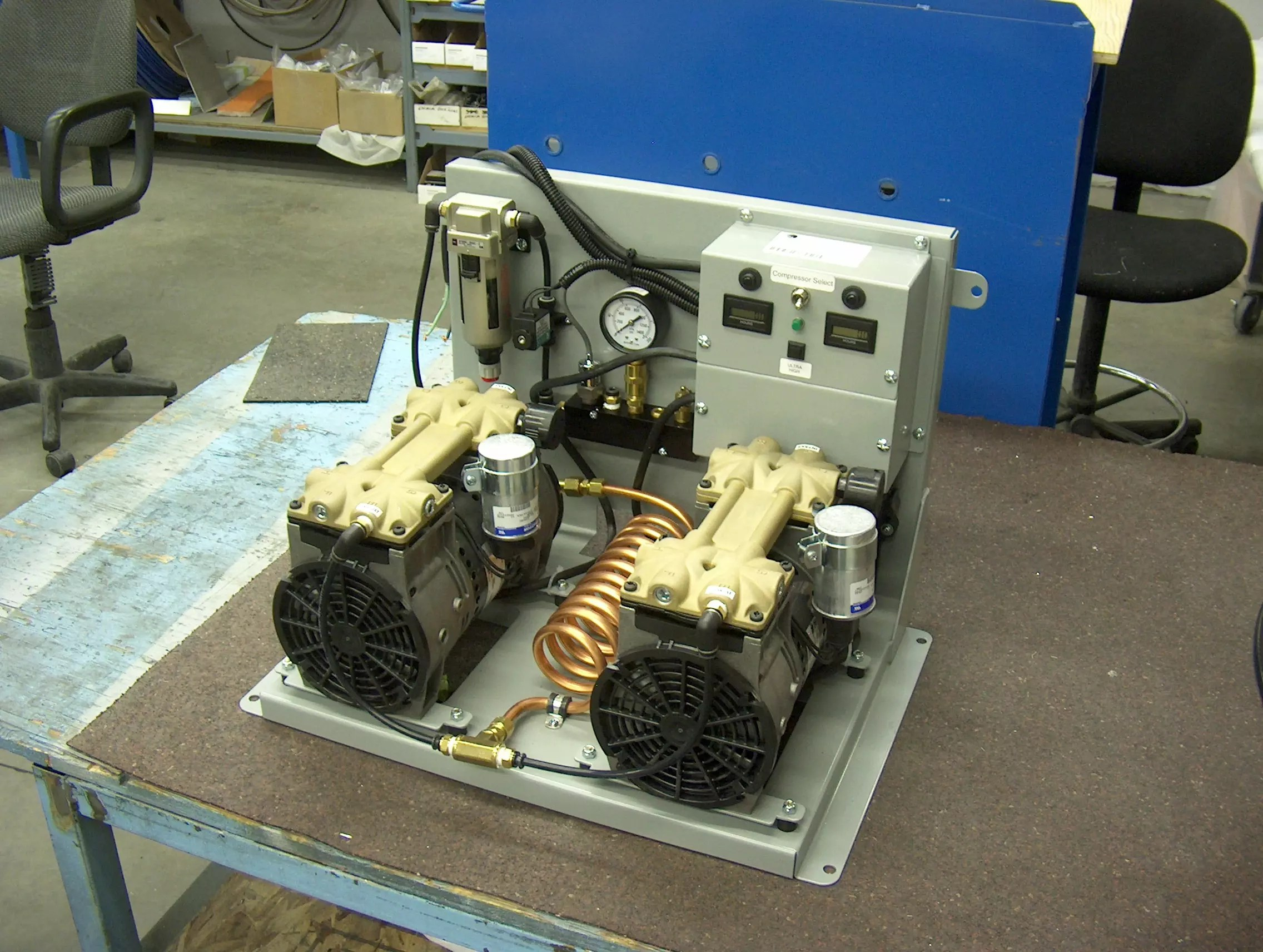 Overhead view of Valid Manufacturing auxiliary air compressor on a table.