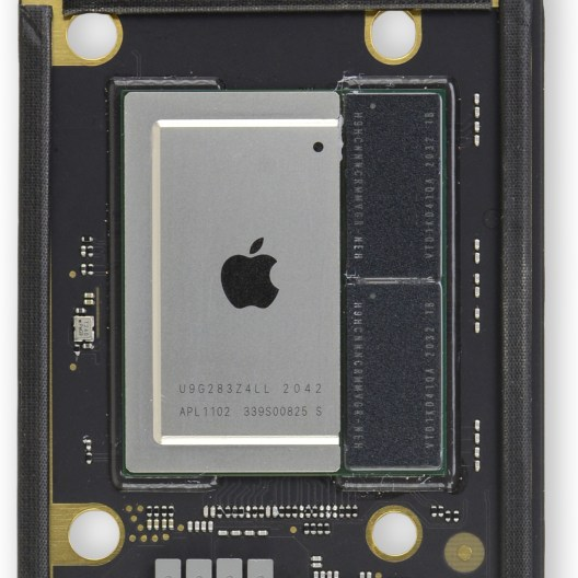 M1 chip with half of shield removed, exposing memory