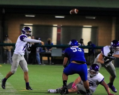 Kennedy McGill throws for the Jags