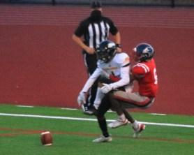 Ioseph Flores knocks the ball away from Emmanuel Cody