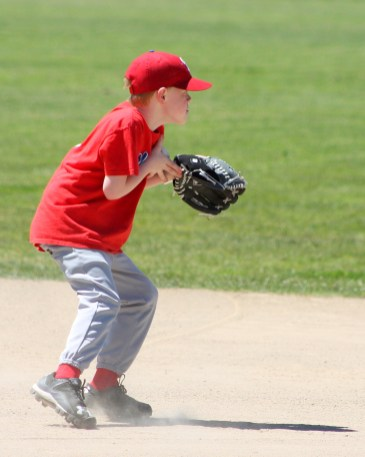 Owen scoops up the ball at third