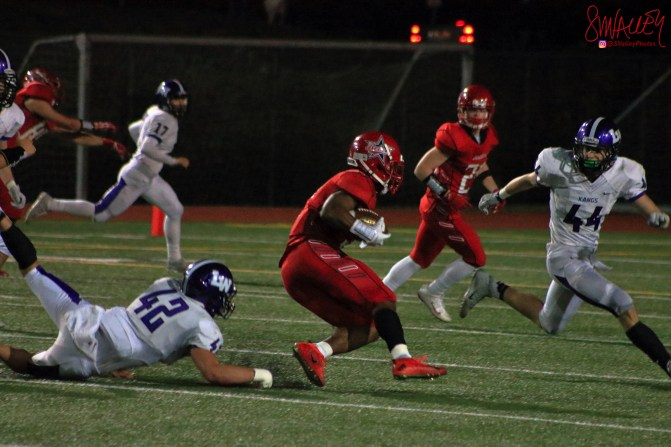Salvon Ahmed rushes for a few of his 226 yards