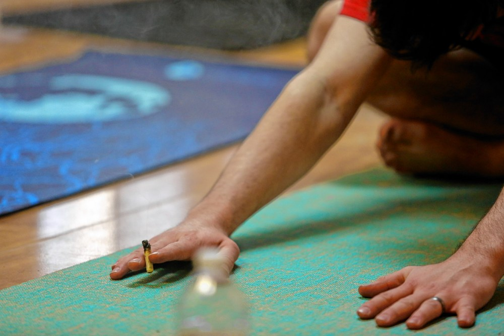 medium resolution of kyle young of easthampton smokes cannabis while stretching april 7 2018 during chronic trips inhale exhale yoga at ora care in springfield