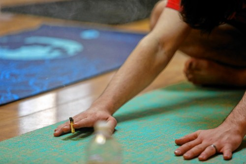 small resolution of kyle young of easthampton smokes cannabis while stretching april 7 2018 during chronic trips inhale exhale yoga at ora care in springfield