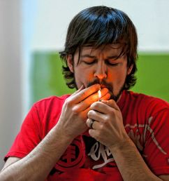 kyle young of easthampton front smokes cannabis april 7 2018 during chronic trips inhale exhale yoga at ora care in springfield  [ 3000 x 2000 Pixel ]