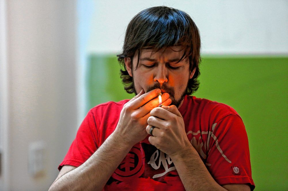 medium resolution of kyle young of easthampton front smokes cannabis april 7 2018 during chronic trips inhale exhale yoga at ora care in springfield