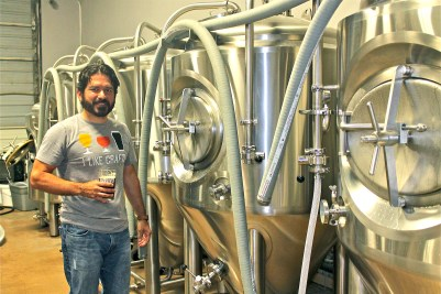 Steve Padilla, owner of Big River Brewery in Pharr, stands in front of his beer vats. Big River Brewery opened in April. (VBR)