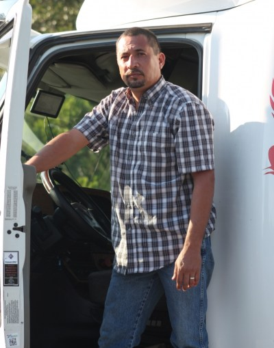 Victor Diaz, owner of VD Transports, and the third truck he's owned since he began his business two years ago. (VBR)