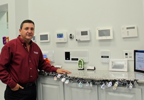 Xtreme Security owner Galiguer Manjarrez with a display of security equipment. (VBR)