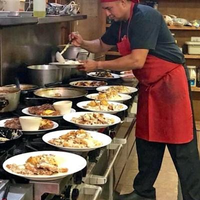Milano's head chef Albert Garcia plates some of the Italian restaurant's signature dishes. (VBR)