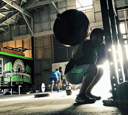 A man works out with weights at Hardknox Strength & Performance Barbell Club. (VBR)