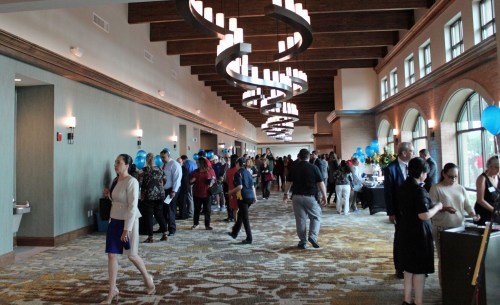 Guests at the convention center dedication filled the lobby as they toured the facility, which featured rooms set up and decorated for different types of community events. (VBR)