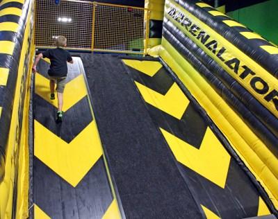 The Ninja Warrior course includes a challenging climb up a treadmill. (VBR)