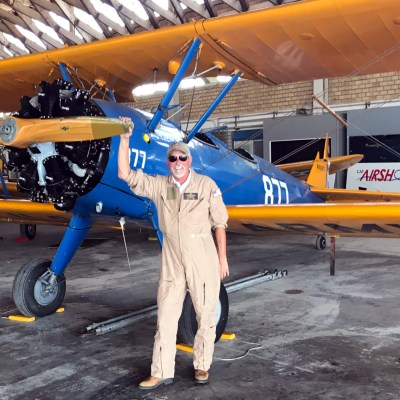 David Hughston, chairman of the CAF board, stands by a PT-17 scheduled to fly.