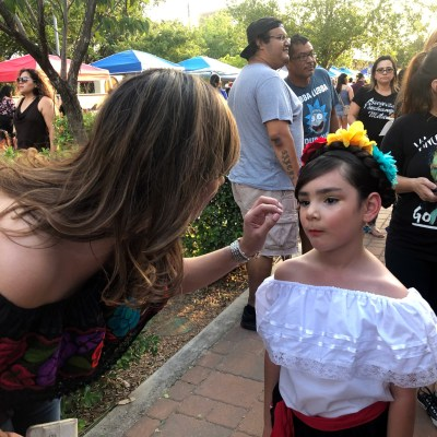 Sherry Cantu helps fix her 6-year-old daughter Natali Ann's costume before the Frida look-alike contest at the recent Edinburg Cultural Arts event FridaFest. (photo Selene D. Garza)