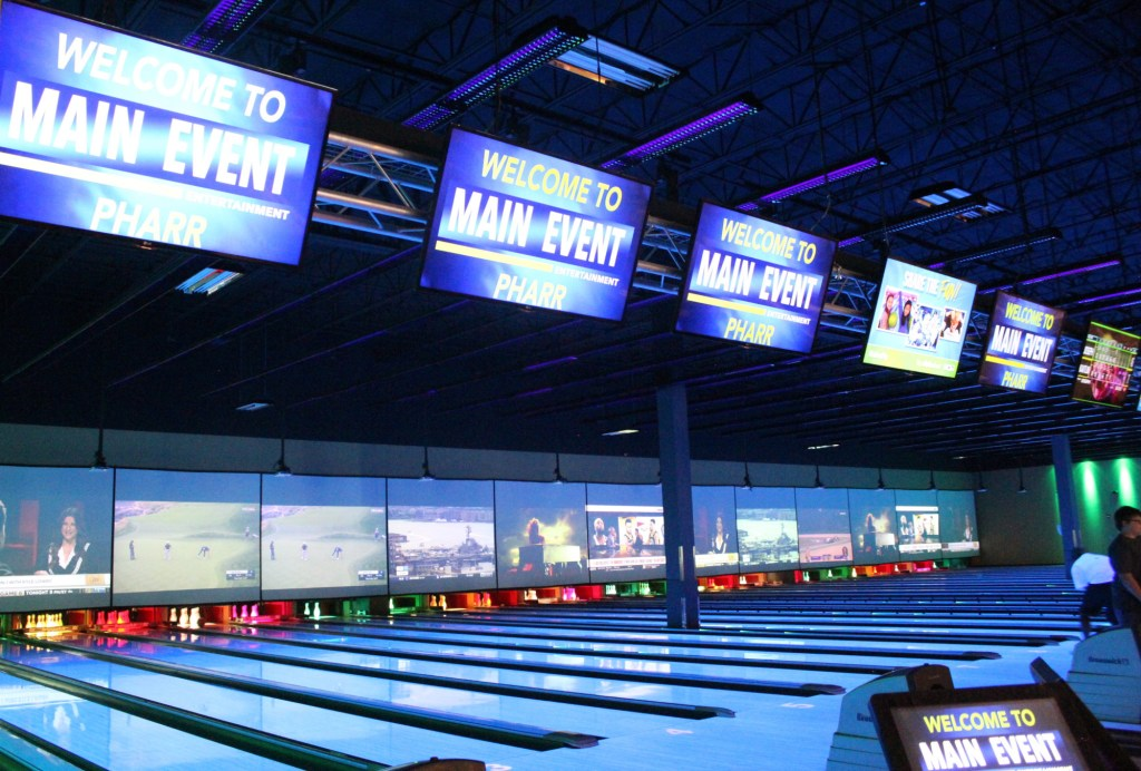 The main attraction at Main Event is the bowling alley complete with video screens and neon lights. (VBR)