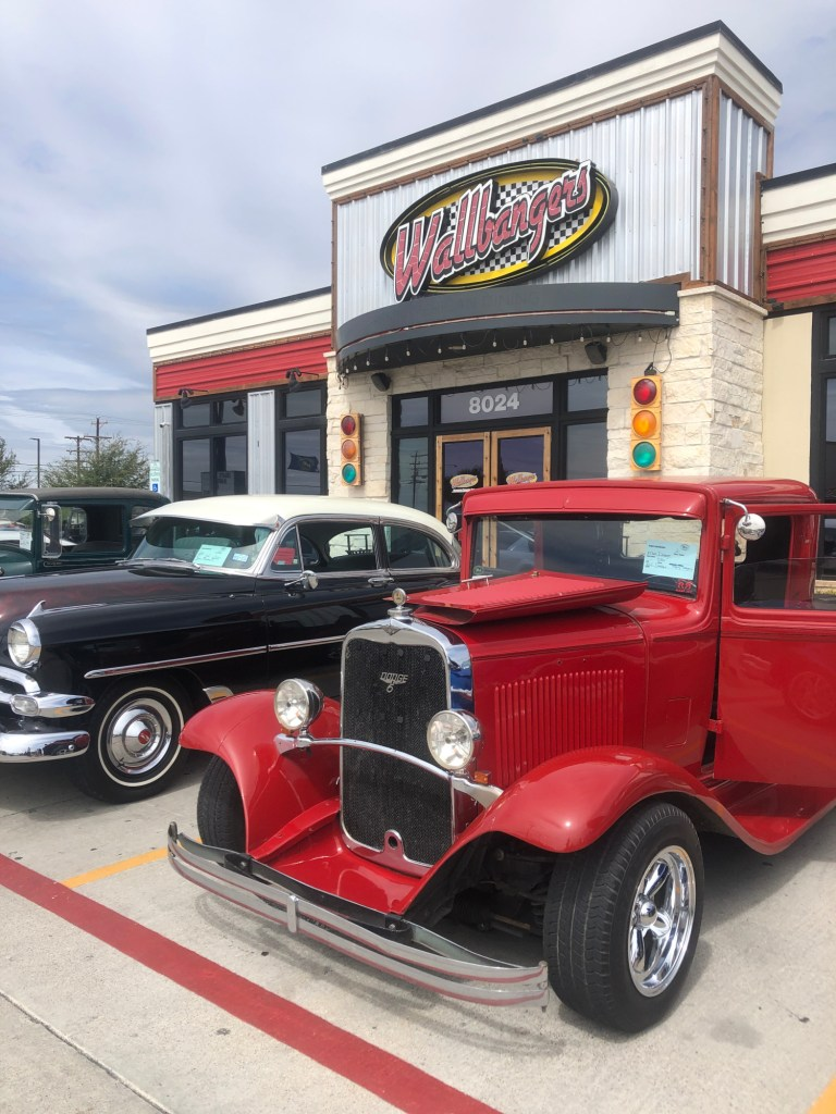 Cars on display at Wallbangers for the AACA RGV Old Car Fest.