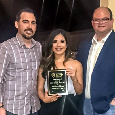 """Ryan and Brian held an award ceremony to recognize their team's achievements. Listing agent Kathleen Mena was honored with """"Top Dog"""" for her dedication and success in 2018."""