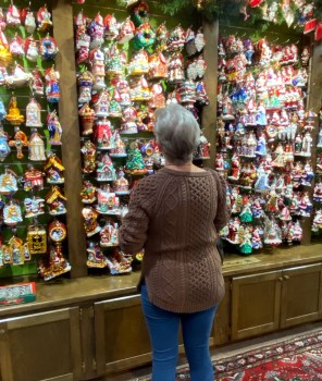 A customer peruses the wall of Christopher Radko ornaments.