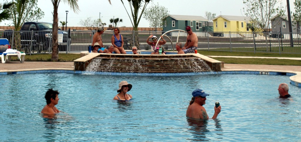 Residents at Tropical Trail enjoy the park's swimming pool
