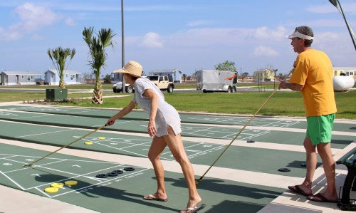 Residents enjoy the shuffleboard courts at Tropical Trail.
