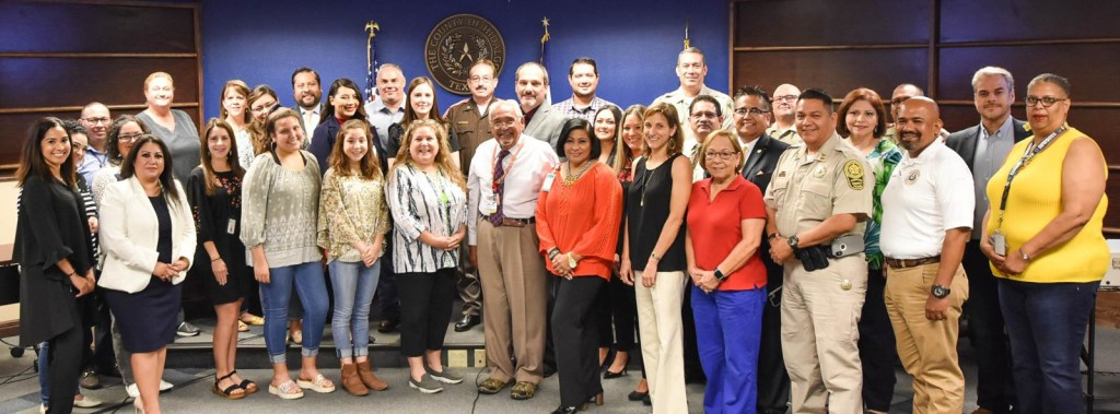 Members of the Hidalgo County Mental Health Coalition pose for a picture in 2019.