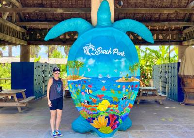 Chelsea Fedigan shows just how tall the latest member of the South Padre Sea Turtle Art Trail is.