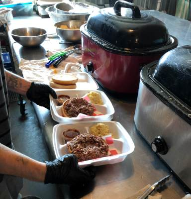 Serving barbecue plates during a recent lunch hour rush at Tucker's in Raymondville.