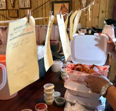 Filling orders during a busy lunch rush at Tucker's in Raymondville.