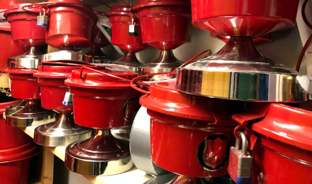 Red kettles in stacks and ready to go for the holidays.