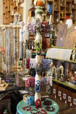 Mari Rodriguez finds great joy in the colors and styles of jewelry and gifts in her store.