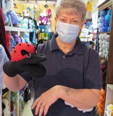 Ann Gamblin has a bit of fun with a hand puppet she designed as an entrepreneurial response to the pandemic.
