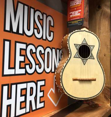 A type of guitar featured in mariachi music is among the instruments at Armonia Music Academy.